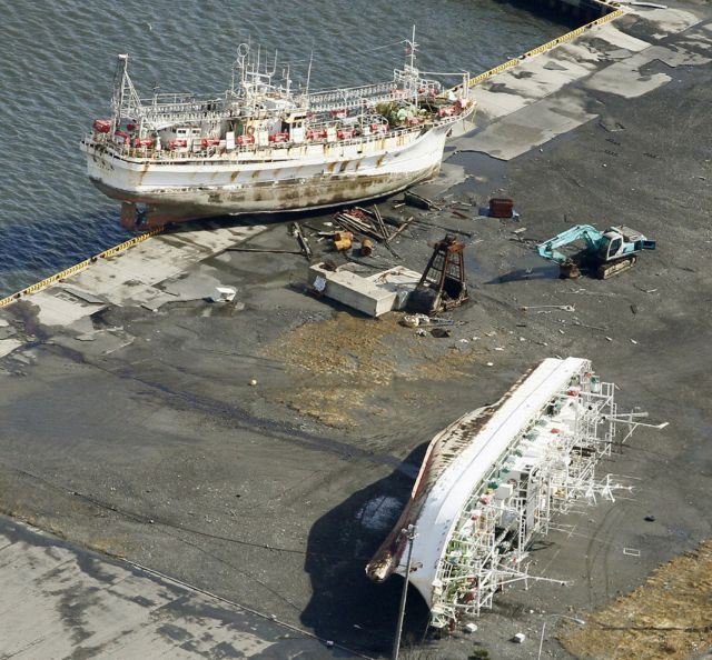 Ships tossed ashore by a tsunami following an earthquake are seen in Aomori Prefecture, northern Japan